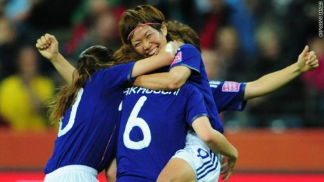 Midfielder Nahomi Kawasumi celebrates Japan's 3-1 victory over Sweden during the women's World Cup.