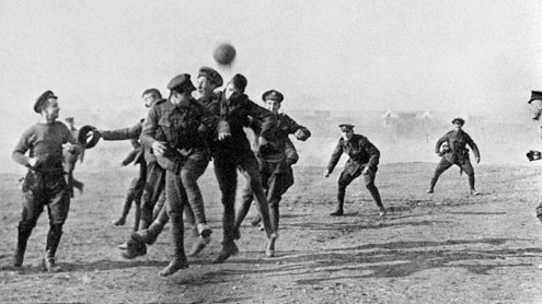 Christmas Day Truce in 1914. Soldiers from opposing sides playing football.