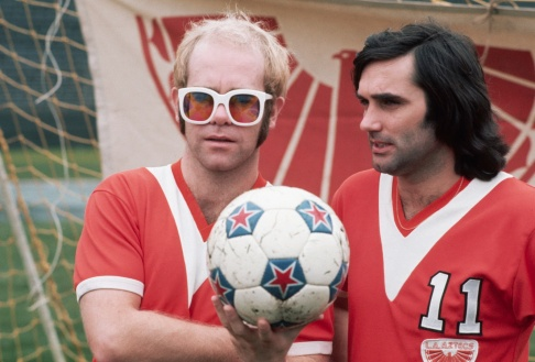 Owner Elton John with new signing George Best in 1976
